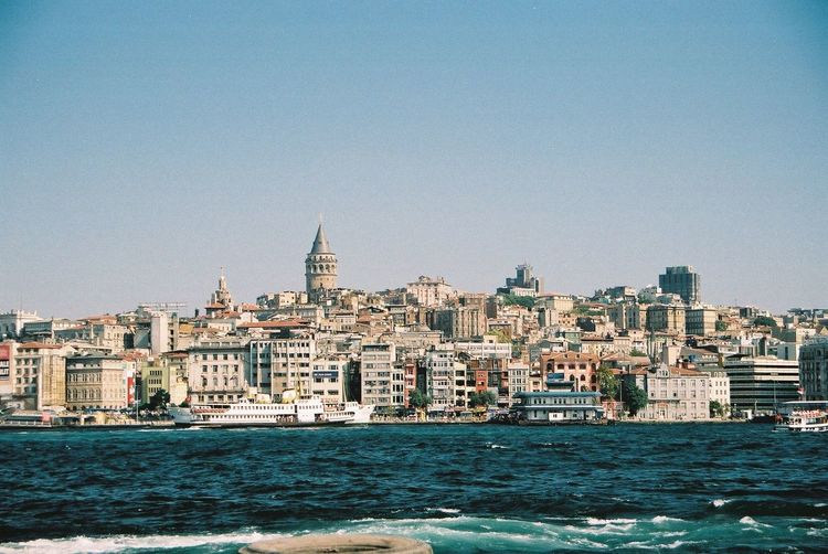 Newer Istanbul & Galata Tower Architecture City Cityscape Clear Sky Composition Day Distant View Galata Tower Istanbul No People Outdoor Photography Outdoors Residential Building Residential District Residential Structure Rippled Sea Ship Tourist Attraction  Travel Destinations Turkey Water Waterfront