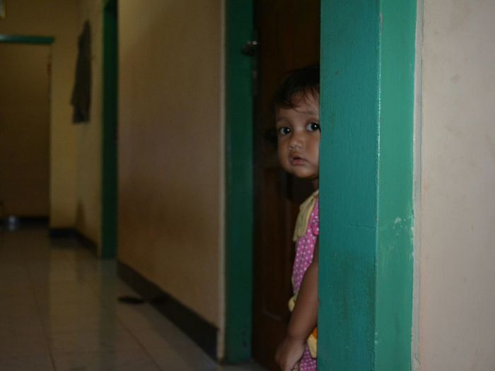 Portrait of innocent girl standing at corridor