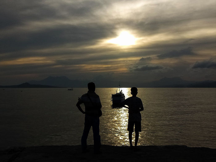 father and son INDONESIA Indonesia_photography Wonderful Indonesia My Best Photo Father And Son Father And Son Time Sea Water Sunset Standing Full Length Beach Silhouette Men Togetherness Sky