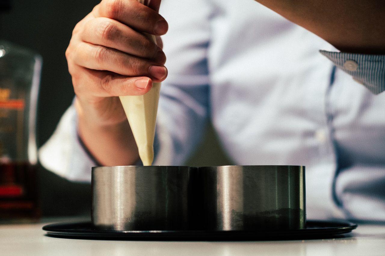 Close up of man hand preparing food