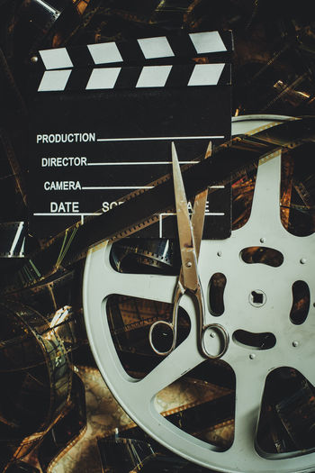 Vintage movie background cinematic color effect concept of editing final cut 35mm Film Cinematic Editing Movies Old Fashioned Retro Scissors Background Cinema Clapboard Clapper Clapper Board Close-up Concept Final Cut Memory Movie Production No People Post Production Reel Slate Symbol The Past Unrolled Filmstrip Vintage