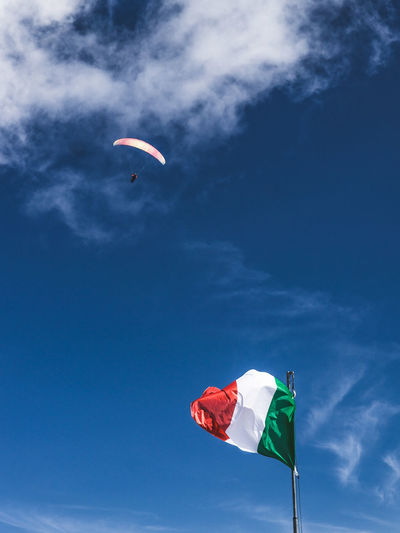 Low angle view of kite flying against sky