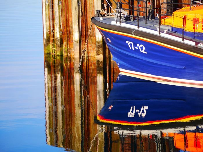 Isle of Barra reflection Scotland Islle Of Barra Lifeboat Lifeboat RNLI Hebrides Transportation Mode Of Transportation Water Nautical Vessel Blue Text Communication Number No People Day Western Script Moored Nature Building Exterior Travel Built Structure Sailboat