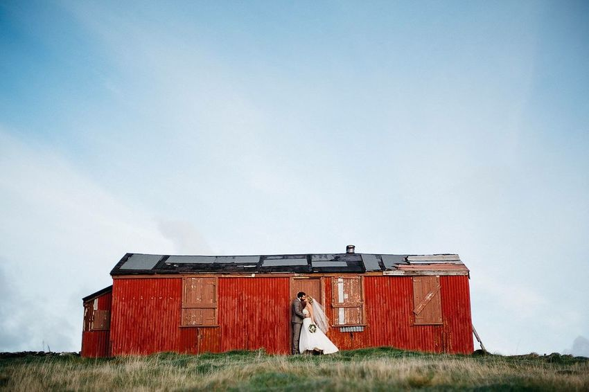 Field Built Structure Architecture Day Sky Building Exterior Outdoors Grass Landscape Nature Isleofman Celebration Event Happiness Real People Love Togetherness Celebration Wife Husband Tranquility Wedding Photography Wedding Dress Weddings Wedding Day Weddings Around The World