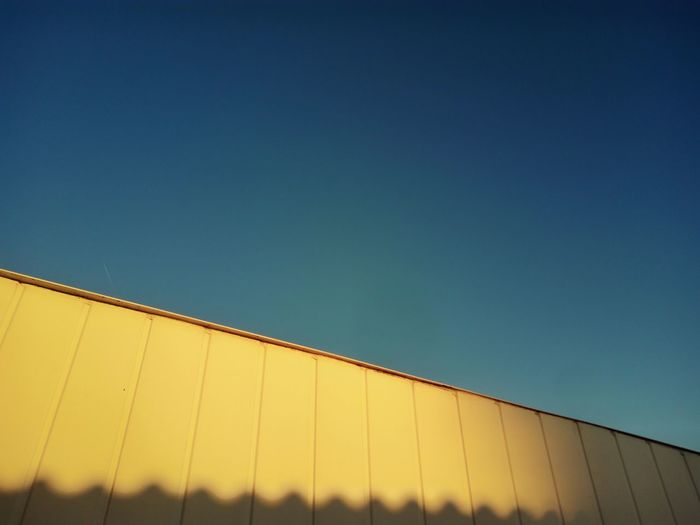 Late afternoon sun. Low Angle View Architecture Yellow Blue Clear Sky Sunlight Warm Glow Paint The Town Yellow