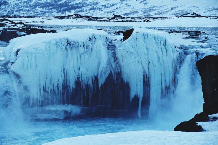 Frozen lake along snowed landscape