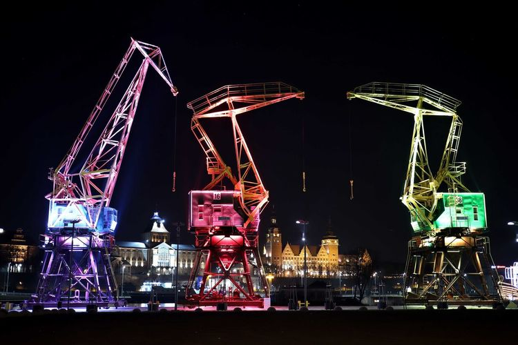 Night Illuminated Arts Culture And Entertainment Amusement Park Water No People Amusement Park Ride Machinery Ferris Wheel Outdoors Crane - Construction Machinery Lighting Equipment Nature Business Copy Space Shipping  Light Architecture Container Nightlife