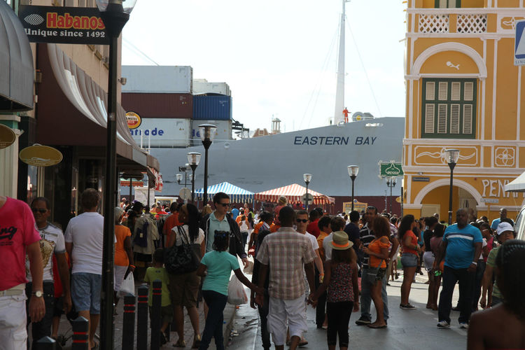 Building Exterior City Life Crowd Downtown Large Group Of People Passing By Penha Punda Ship Ship In Town Traffic Vessel