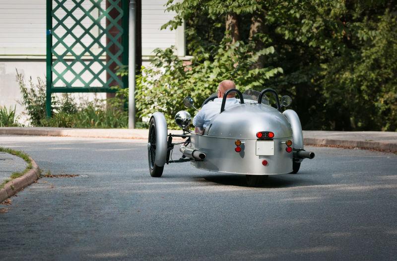 A fun little three-wheeler car Antique Car Funny Three-wheeled Motor Car Three-wheeler Day Outdoors Road Transportation Vintage Cars