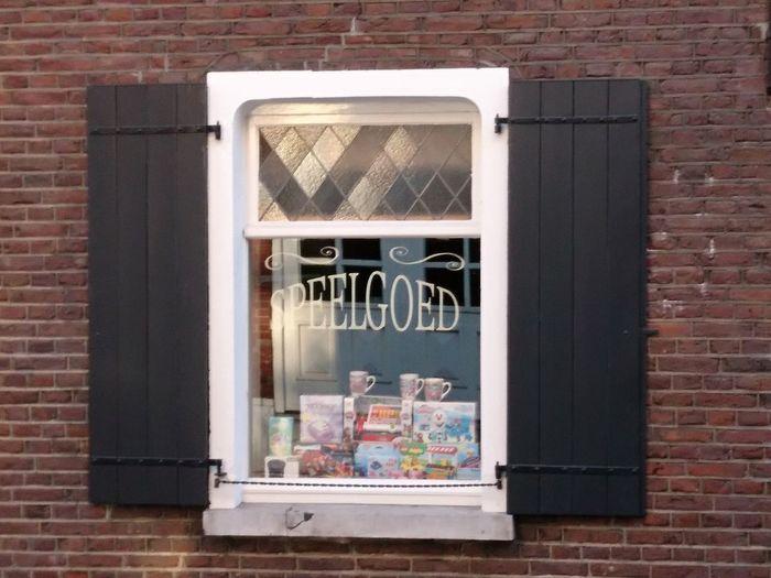 Reflection of window on brick wall