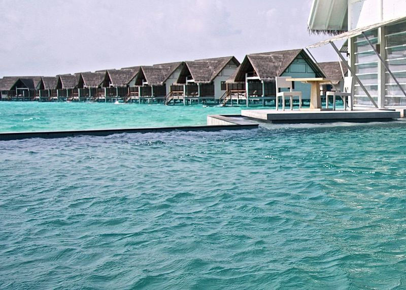 Architecture Beach Beauty In Nature Blue EyeEm Gallery Holiday Life Is A Beach Lifestyles Maldives Modern Ocean Pool Poolside Rippled Scenics Sea Sky Table And Chairs Take Your Place Taking Photos Tranquil Scene Travel Turquoise Colored Watervillage Wineandmore
