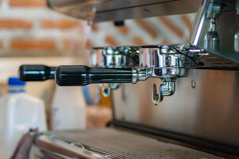 Close-up of coffee machine ready to make espresso by barista.