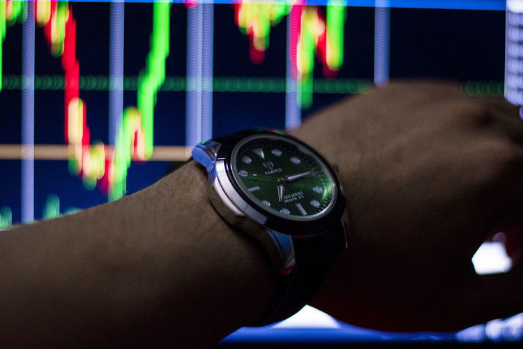 See stock chart time See Stock Chart Time Watch Hand Human Hand One Person Wristwatch Time Human Body Part Real People Close-up Body Part Men Indoors  Lifestyles Number Technology Adult Human Joint Leisure Activity Focus On Foreground Checking The Time Wrist Human Limb