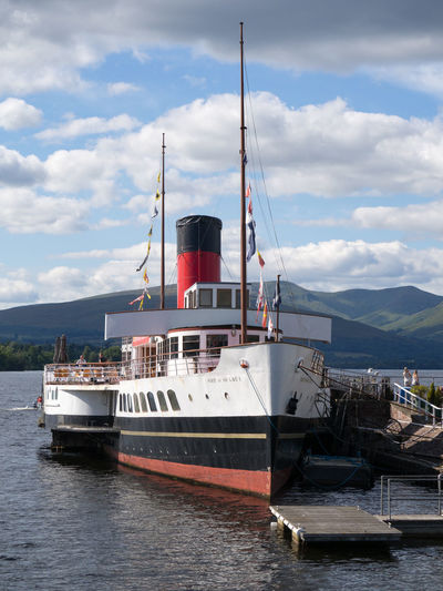 """Maid Of The Loch"" at Balloch Pier, Loch Lomond Balloch Pier Cloud - Sky Day Harbor Maid Of The Loch Mast Mode Of Transport Moored Mountain Nautical Vessel No People Outdoors Sky Steam Ship Transportation Water Waterfront"
