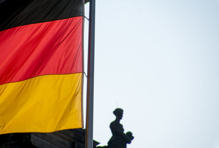 Low Angle View Of German Flag Against Clear Sky