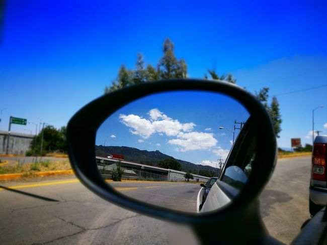 Side-view Mirror Mirror Reflection Vehicle Mirror Transportation Road Car Sky Day No People Close-up Outdoors Reflection HuaweiP9Photography NewEyeEmPhotographer Travel Destinations EyeEmNewHere Rethink Things Perspectives On Nature