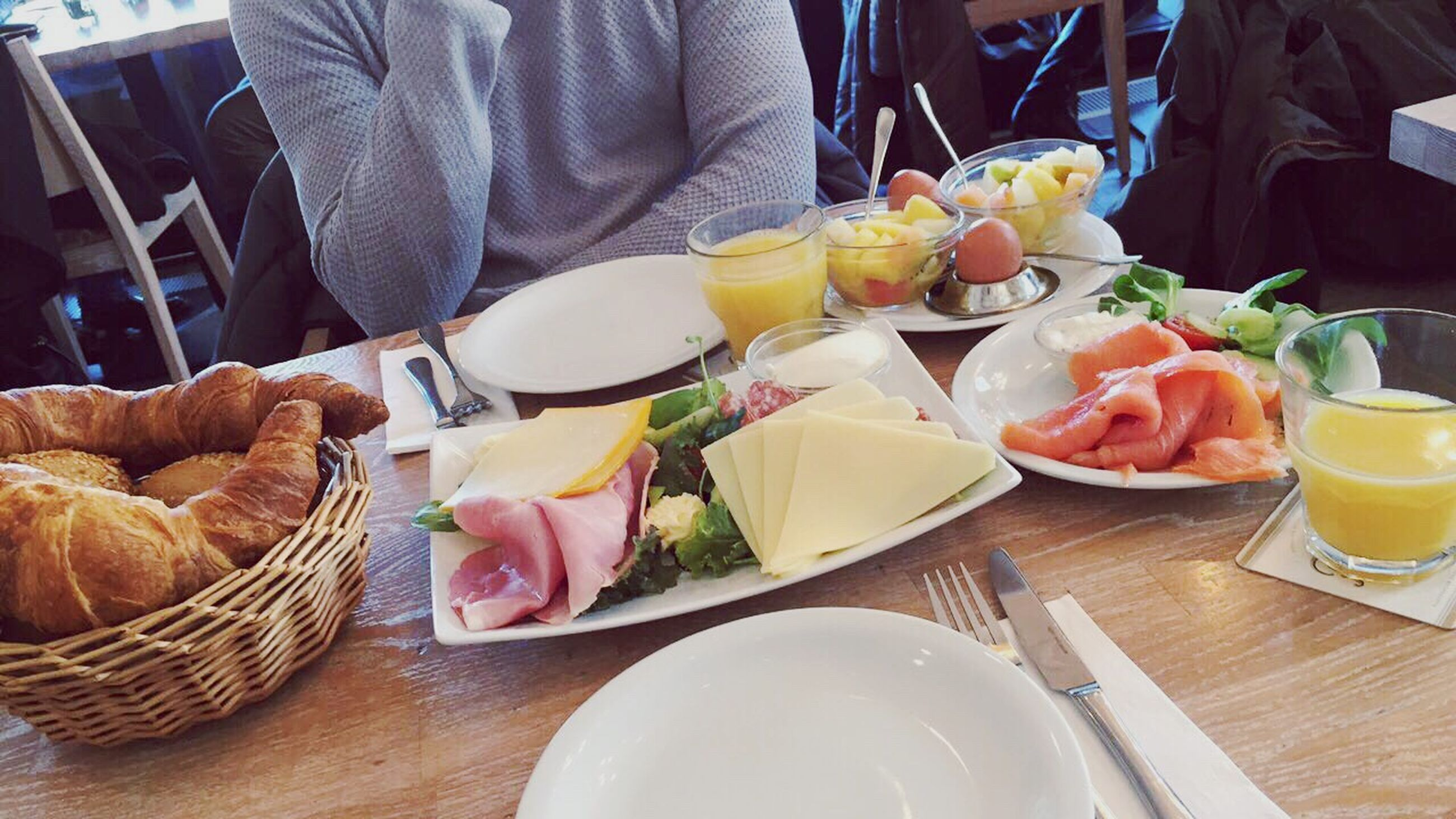 table, breakfast, food and drink, plate, food, women, midsection, meal, drink, adult, freshness, adults only, people, one person, ham, ready-to-eat, human hand, indoors, human body part, day