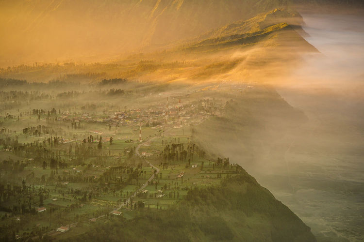 Golden hour in the morning at Bromo, Indonesia Scenics - Nature Environment Beauty In Nature Fog Landscape Nature Sky No People Tranquil Scene Tranquility Aerial View High Angle View Architecture Sun Mountain Outdoors Land Sunset Patchwork Landscape Cityscape Golden Hour
