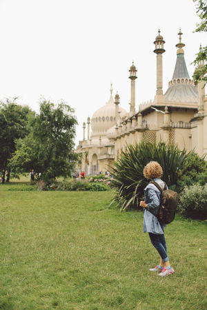 Architecture Backpack Blonde Brighton Built Structure Casual Clothing Curly Hair Day Full Length Girl Grass Green Color Lawn Leisure Activity Lifestyles Outdoors Plant Royal Pavilion Royal Pavilion Gardens Sky Tourism Tourist Travel Destinations Your Ticket To Europe Been There. Connected By Travel