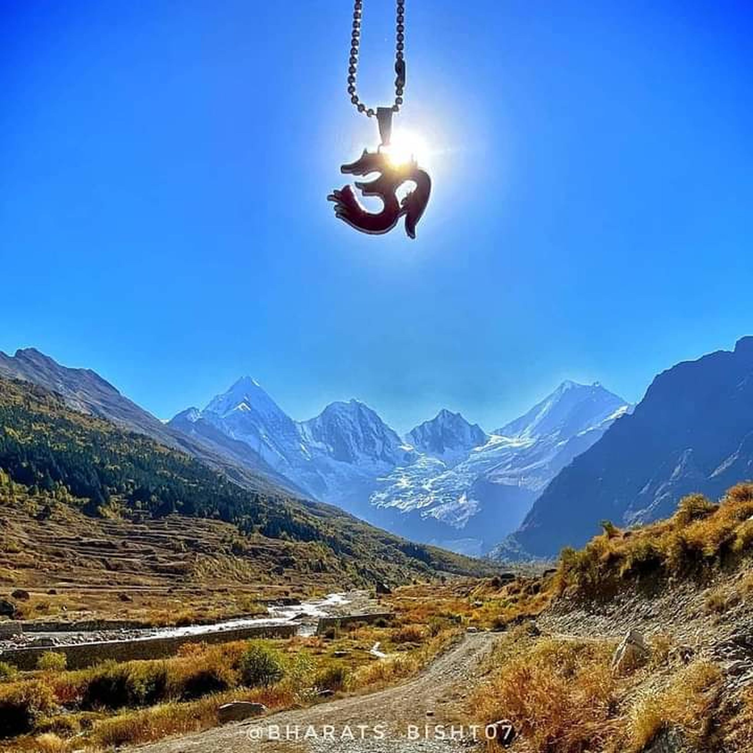 mountain, sky, nature, adventure, mountain range, mid-air, scenics - nature, landscape, environment, sports, leisure activity, one person, beauty in nature, activity, land, extreme sports, motion, blue, snow, hanging, transportation, outdoors, travel, day, joy, full length, jumping, sunlight