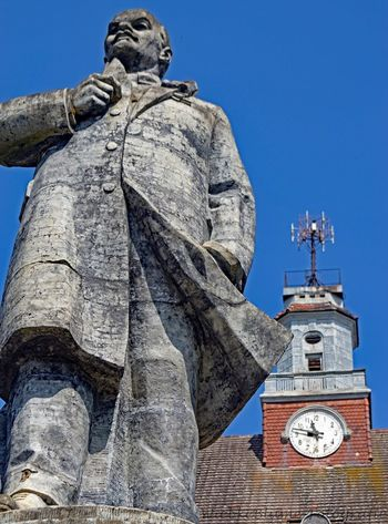 Lost Places Lenin Vladimir Iliich Architecture Belief Building Building Exterior Built Structure Clock Human Representation Low Angle View No People Place Of Worship Religion Representation Sculpture Sky Spire  Spirituality Statue Time Tower Travel Destinations