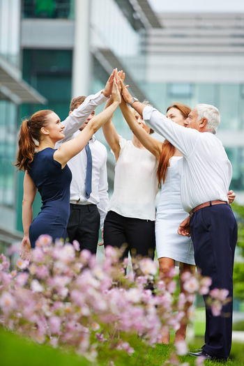 Business People Doing High Five Outdoors