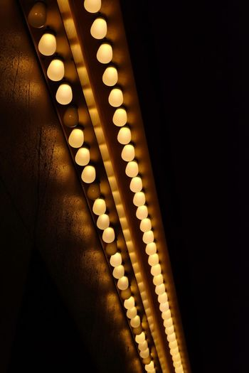 Low angle view of illuminated lights