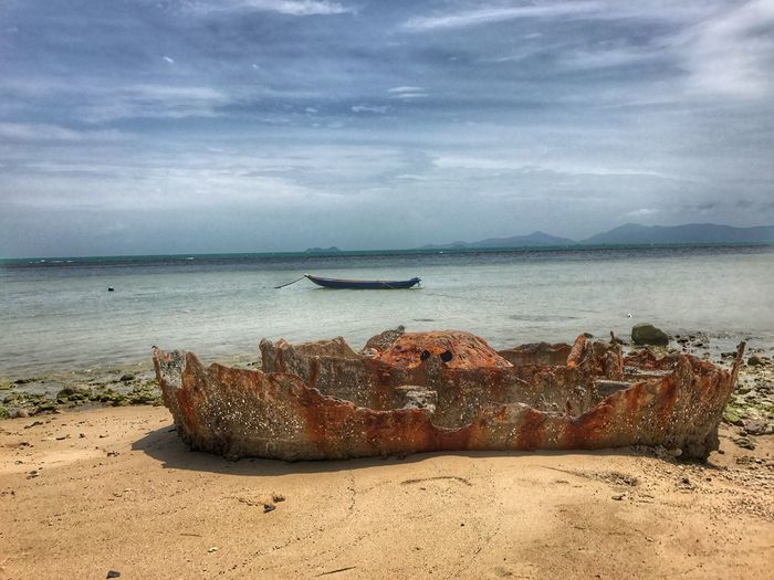 Sea Beach Water Sand Horizon Over Water Sky Nature Cloud - Sky Scenics Beauty In Nature Tranquility Rock - Object Day Tranquil Scene No People Outdoors Nautical Vessel