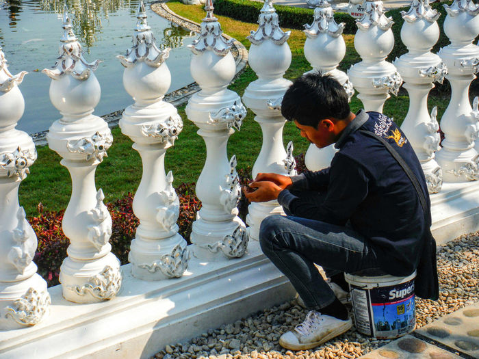 Repairing White Temple White Temple Thailand Chiang Rai Chiang Rai, Thailand Chiang Rai | Thailand Wat Rong Khun WatRongKhunWhiteTemple Watrongkhun Wat Rongkhun Temple Architecture Repair Repairs Repairing Repair Work Fence White Fence Repairman One Person One Man Only Day Focused Outdoors Fixing Things White Fences