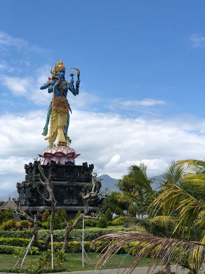Bali Hinduism Travel Architecture Art And Craft Belief Cloud - Sky Creativity Day Female Likeness Human Representation Low Angle View Male Likeness Nature No People Outdoors Plant Religion Representation Sculpture Sky Spirituality Statue Tourism Tree