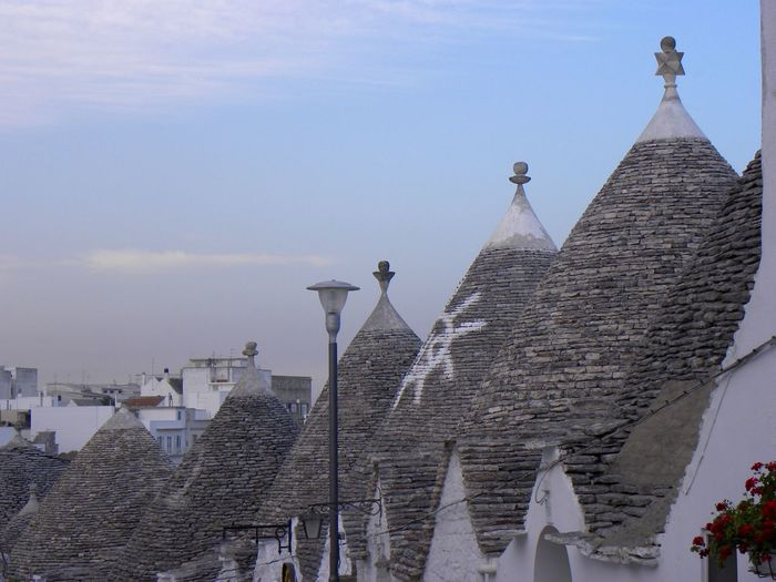 Alberobello Alberobello - Puglia Alberobello City Alberobellocity Alberobelloexperience Alberobellophotocontest Architecture Building Exterior Built Structure Day No People Outdoors Place Of Worship Religion Sky Spirituality Let's Go. Together.