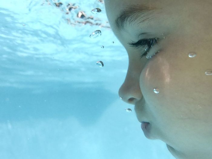 Close-up of girl swimming in pool
