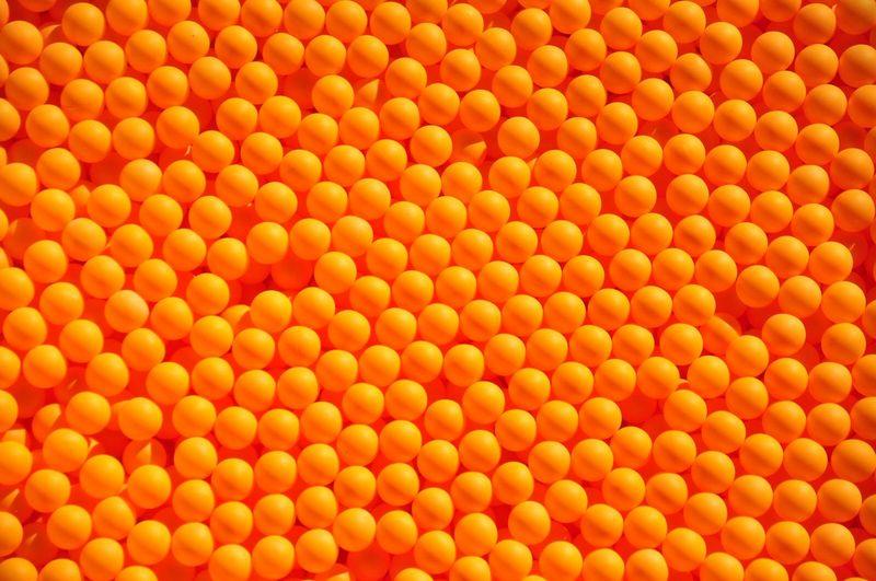 Full frame shot of orange table tennis balls