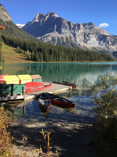 Boats Moored By Jetty At Emerald Lake