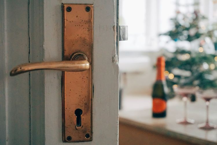 home for christmas Copy Space Christmas lights christmas Still Life StillLifePhotography Copy Space Christmas Lights Christmastime Champagne Celebration Celebrating Holiday Holidays Wine Glass Champagne Glasses Lock Protection Door Safety Wood - Material Security Close-up Front Door Keyhole Doorknob Open Door Door Knocker Entryway Handle