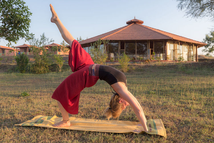 Yoga Yoga Pose Asana Balance Day Exercising Field Flexibility Full Length Grass Healthy Lifestyle Leisure Activity Lifestyles Nature One Person Outdoors People Real People Sky Tree Women Yoga Yogagirl Young Adult Young Women