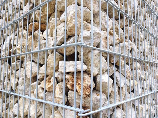 Full Frame Backgrounds Human Body Part Outdoors Day Close-up People Cage Stone Corner
