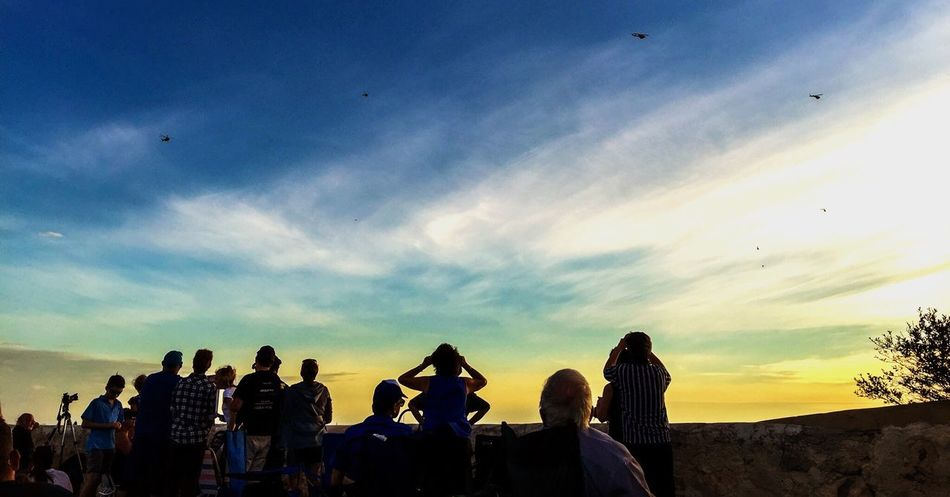 Waiting for the Sunset Waiting For Sunset Sunset Sky Blue Orange Yellow Evening Twilight Incidental People People People In Silhouette Silhouettes Night Gathering Helicopters Group Crowd Community Togetherness Romantic Sunset Silhouettes