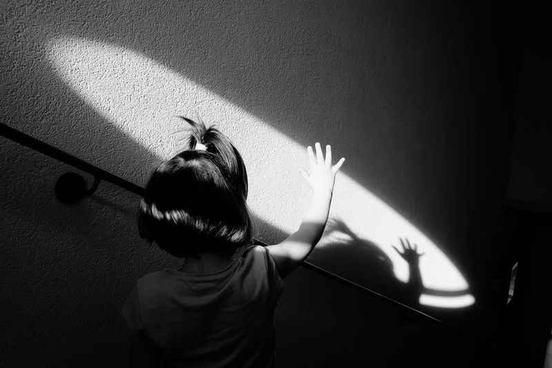 Hi 5 Shadow Real People One Person Child Leisure Activity Childhood Sunlight Lifestyles Waist Up Indoors  Day Headshot High Angle View Nature Men Arms Raised Boys Rear View Portrait Focus On Shadow