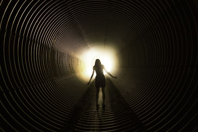 Full Length Rear View Of Woman Standing In Tunnel
