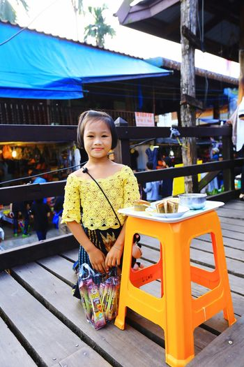 Myanmar Powder Extra Income Help Working Parents Unearned Income Finding Tanaka Starch Looking At Camera Portrait One Person Childhood Child Smiling Children Only Full Length Day Outdoors Girls Standing Real People People Sitting Happiness Lifestyles Supermarket Adult