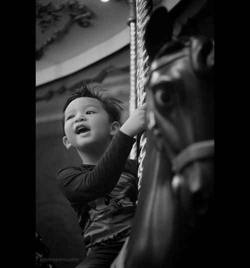 le carrousel Childhood Child Happiness Black And White Photography FUJIFILM X-T10 35mmf1.7 35mm Meike Fujifilm Fuji Blackandwhite Carousel Merrygoround First Eyeem Photo Fujifilm_xseries Live For The Story The Portraitist - 2017 EyeEm Awards Place Of Heart EyeEmNewHere EyeEm Selects