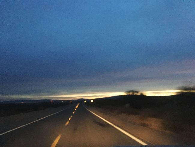 The Way Forward Road Transportation Sky Landscape Outdoors Scenics Sunset Day Blurred Perspective Twilight Scene Headlights Drivingshots