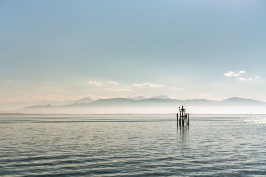 Lake Constance Sky Beauty In Nature Water Scenics - Nature Waterfront Tranquil Scene Tranquility Non-urban Scene Idyllic Nature Lifestyles Mountain Sea Reflection Outdoors Warning Sign Navigation Shipping  Lake Mountain Range Mountains Fog Security Foggy