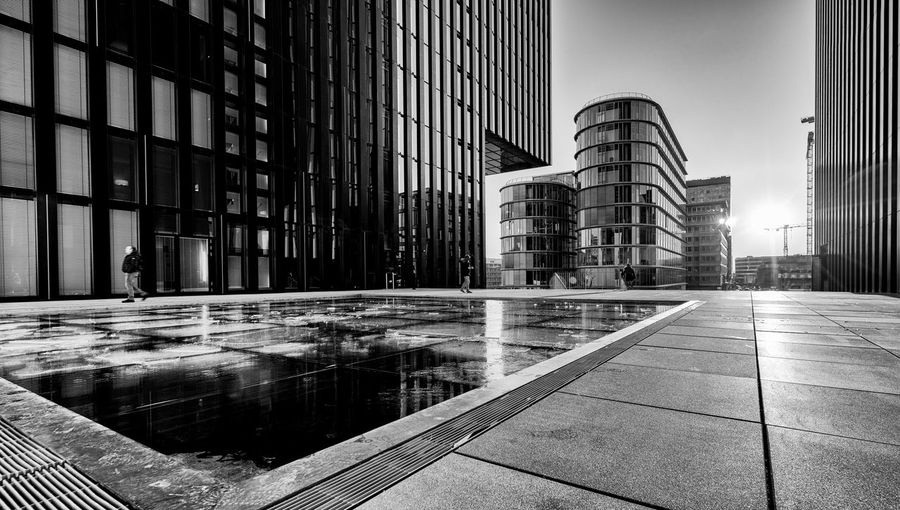 Spectacular B&W sundown in New Harbour City Built Structure Architecture Building Exterior City Building Office Reflection Office Building Exterior Modern Nature Day No People Water Tall - High Outdoors Glass - Material Sky Street Tower Skyscraper Tiled Floor Financial District  B&w Photography Dramatic Lighting #duesseldorf