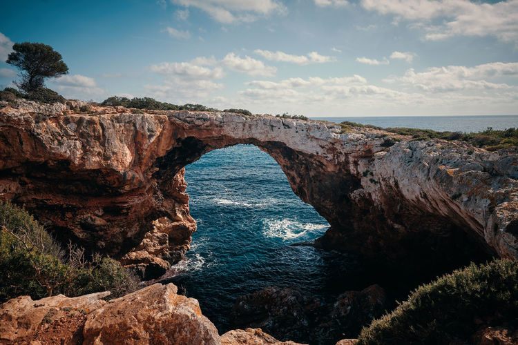 Mallorca Arch Beauty In Nature Cliff Day Horizon Over Water Natural Arch Nature No People Outdoors Physical Geography Rock - Object Rock Formation Scenics Sea Sky Tranquil Scene Tranquility Water