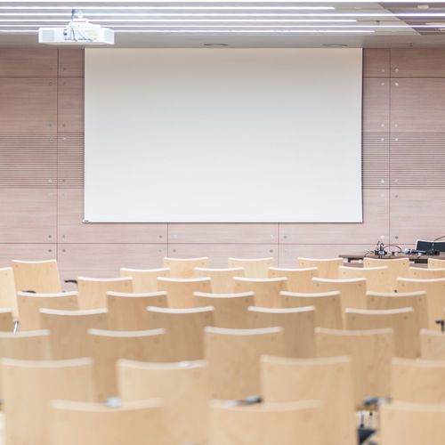 Empty chairs and tables in conference room