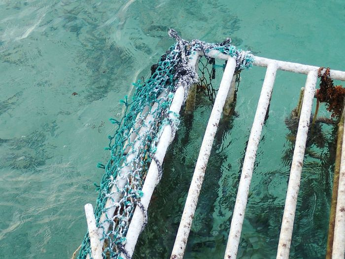 High angle view of safety cage in sea