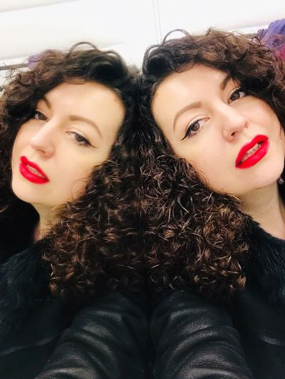 Yes, there are two of us. Curly Hair Duality Mirror Reflection Twins Young Adult Portrait Lipstick Make-up Young Women Beautiful Woman Red Lipstick Women Hairstyle Looking At Camera Beauty Real People My Best Photo International Women's Day 2019