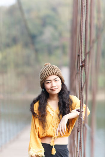 Beautiful Woman Casual Clothing Day Fashion Focus On Foreground Front View Leisure Activity Lifestyles Long Hair Looking At Camera Nature One Person Outdoors Portrait Real People Scarf Smiling Standing Tree Warm Clothing Young Adult Young Women